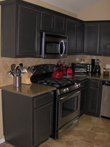 Kitchen Cabinets painted a satin black then distressed and antiqued.